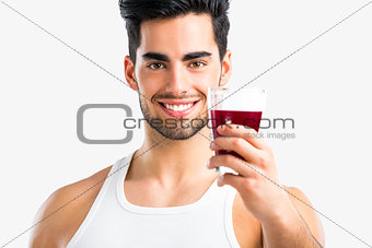 Athletic man drinking a juice
