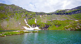 Idyllic view of Balea Lake shore in Fagaras Mountains
