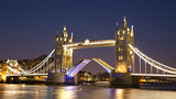 Tower Bridge raised at night