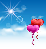 Two glossy hearts balloons for Valentine Day flying in the blue