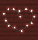 Garland heart shaped on wooden background for Valentine Day