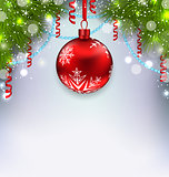 Christmas glowing background with glass ball, fir branches, stre