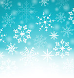 Xmas blue background with snowflakes and copy space for your tex