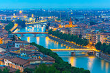 River Adige and bridges in Verona at night, Italy