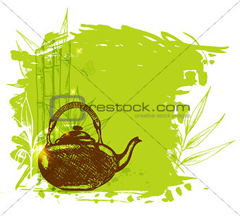 Green bamboo branch and teapot