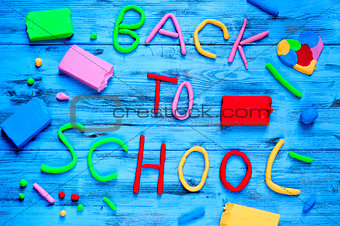 back to school written with modelling clay of different colors
