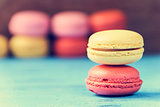 macarons on a blue rustic surface, cross processed