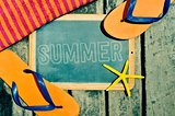 flip-flops, starfish and chalkboard with the word summer