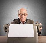 Elder writes with typewriter