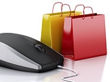 3d computer mouse with shopping bags. E-commerce