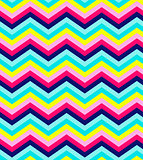Blue, pink, red and turquoise chevron seamless pattern background vector