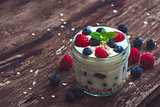 Yogurt with Fresh Berries on Woden Table