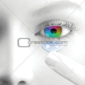 A woman puts a contact lens.