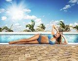 Sunbathes on poolside