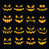 Scary Halloween orange pumpkin faces icons set on black