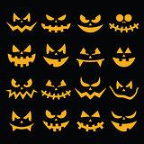 Scary Halloween orange pumpkin faces icons set on black