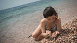 young girl the teenager on a sea beach