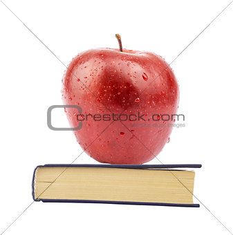 Fresh apple on book