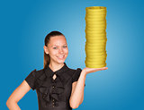 Woman holding coins stack