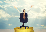 Businesswoman in chair on coins stack, rear view