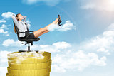 Businesswoman sitting in chair on coins stack