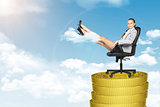 Businesslady sitting in chair on coins stack