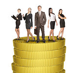 Group of business people standing on coins stack