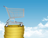 Shopping cart on coins stack