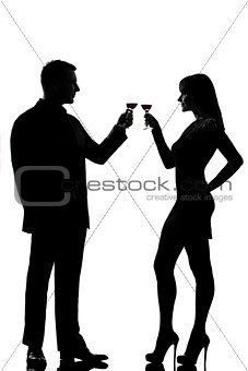one couple man and woman drinking red wine toasting silhouette