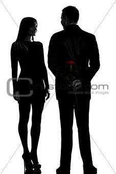 one couple man hiding rose flower and woman smiling silhouette