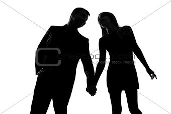 one couple man and woman hand in hand silhouette