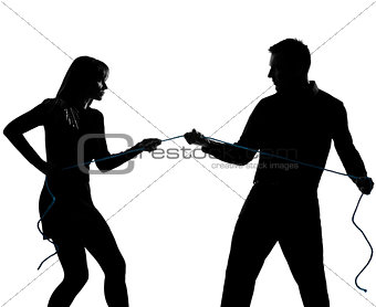 one couple man and woman pulling a rope silhouette