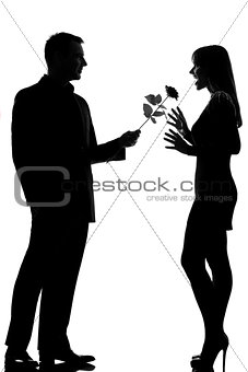 one couple man offering rose flower and woman  silhouette