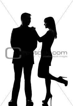 one couple man and woman standing face to face silhouette