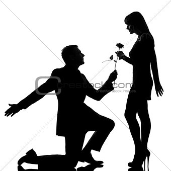 one couple man kneeling offering rose flower and woman smiling s