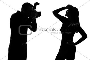 one couple man photographer and woman fashion model silhouette