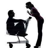 couple woman  with man sitting in shopping cart silhouette