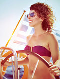 Happy woman driving sailboat