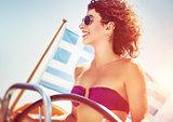 Joyful woman driving sailboat