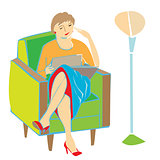 woman reading on armchair