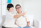 Senior using smart phone making selfie