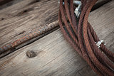 Abstract Rusty Iron Cable Laying on Old Wood Planks
