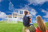 Young Family Facing Ghosted House Drawing Behind