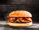Burger with bacon and vegetables