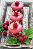 Macaroons with raspberries.