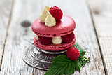 Macaroon with ripe raspberries.
