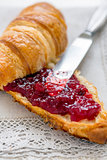 Croissant with jam for breakfast.