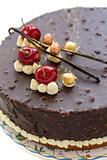 Chocolate cake with cherries.