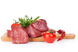Raw fillet beef steak and spices on cutting board