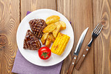 Steak with grilled potato, corn and tomato